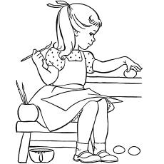 Menina pintando ovo de Páscoa para colorir