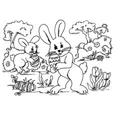 Coelhos caçando ovos de Páscoa para colorir